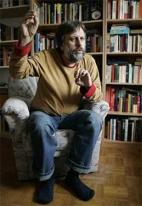 Slovenian critical theorist and philosopher Slavoj Zizek pointing and sputtering comfortably at home.